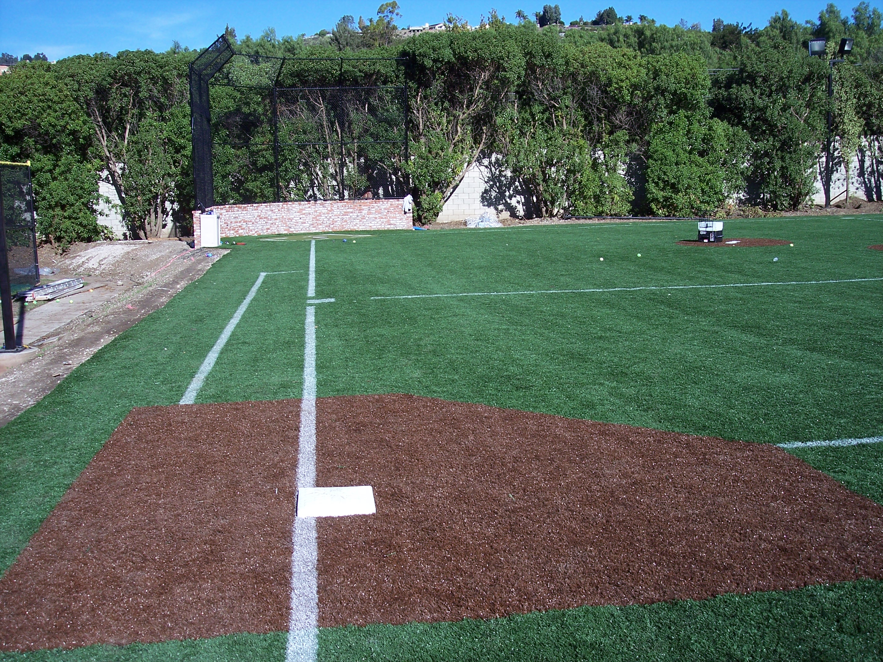 how to prepare base for artificial grass
