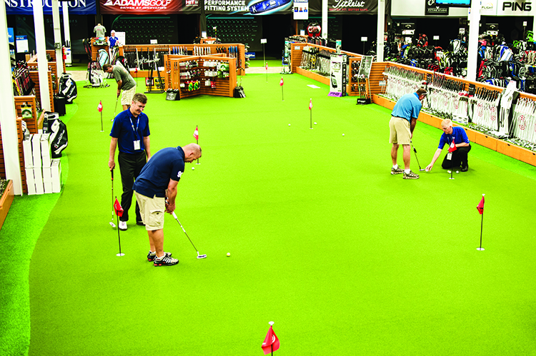 Visitors to the PGA Tour Superstore try out new putters on the STI putting greens, courtesy of Bobby Baughn of STI Atlanta.